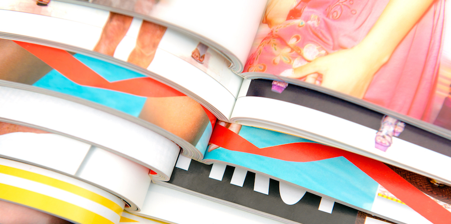 colorful print advertisements stacked on top of one another